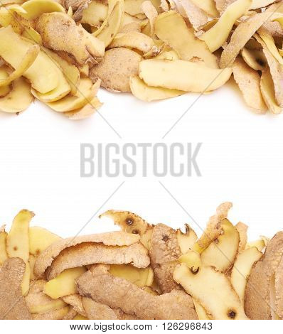 Pile of brown potato peels isolated over the white as a  copyspace background composition