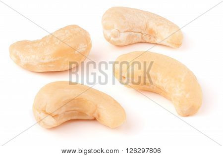 a few cashew nuts on a white background close-up.