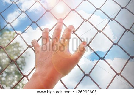 Women Hand Catching Rusty Iron Bar With Tree And Wide Blue Sunny Sky Background And Copy Space
