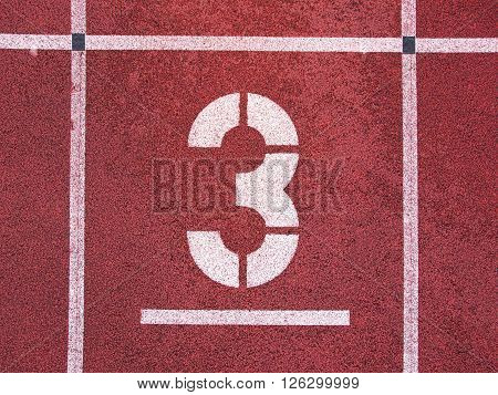 Number Three. White Track Number On Red Rubber Racetrack, Texture Of Running Racetracks In Athletic