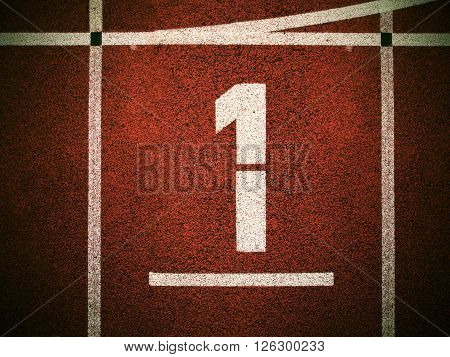 Number One. White Track Number On Red Rubber Racetrack, Texture Of Running Racetracks In Small Outdo