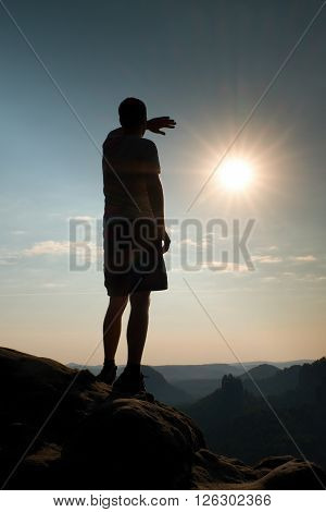 Hiker Stands On Peak Of Rock In Rock Empires Park And Watching Over The Misty And Foggy Morning Vall