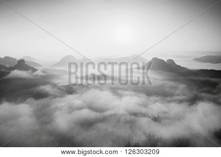 Autumn Sunrise In A Beautiful Mountain Within Inversion. Peaks Of Hills Increased From Foggy Backgro