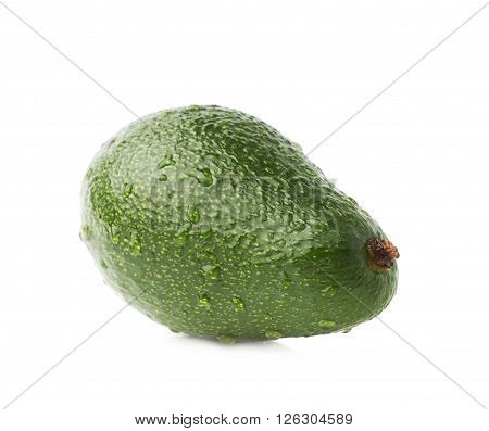 Single ripe green avocado fruit covered with water drops, isolated over the white background