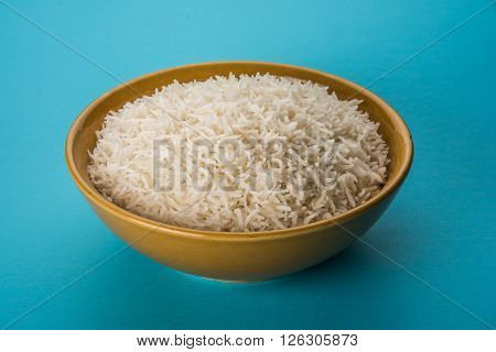 cooked white rice in a bowl, plain basmati rice, cooked basmati rice served in a ceramic bowl