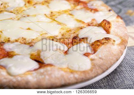 pizza tomato, mozzarella and scamorza on dish