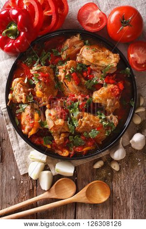 Chicken Stew With Vegetables On A Table Close-up. Vertical Top View