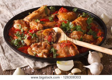 Chicken Stew With A Tomato, Onion And Pepper Close-up. Horizontal