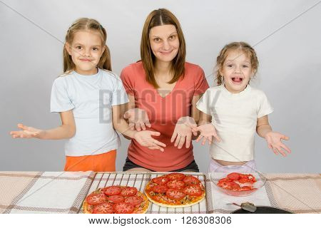Mom With Two Young Daughters Happily Show Made Pizza With Tomatoes