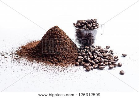 Coffee series : Roasted coffee beans and grounded coffee beans on white background