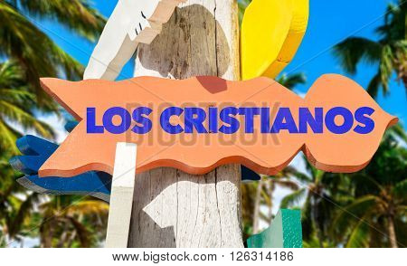 Los Cristianos signpost with palm trees