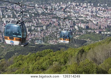 Skopje, Macedonia - April16, 2016: Aerial View Of Cable Car On Vodno Mountain And Background Of Capi