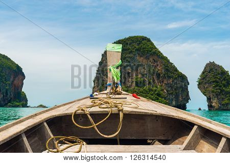 In Front View Of Long Tail Boat Traveling To Island