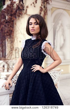 Young Beautiful Stylish Girl Posing In Short Black Dress. Outdoor Summer Portrait Of Young Classy Wo