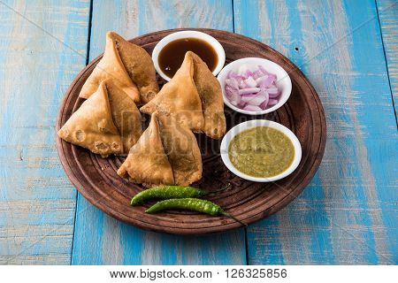 Veg potato Samosa with sauces, Homemade Fried Indian Samosa with Mint Chutney Sauce, famous indian tea time snack