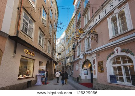 Salzburg Austria - January 07 2016: People walking on the Jew's lane nearby the Alstadt Hotel medieval part of Salzburg