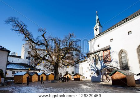 Salzburg Austria - January 07 2016: Tourists walking on the square of Hohensalzburg Castle