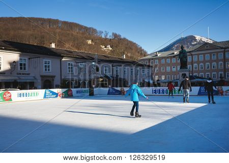 Salzburg Austria - January 07 2016: People have fun skating on a public ice rink of Salzburg