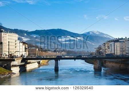Salzburg Austria - January 07 2016: View of the bridge over the Salzach river on the background of mountains