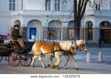 Salzburg Austria - January 07 2016: Horse carriage in the street of city winter time