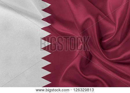 Flag of Qatar waving in the wind.