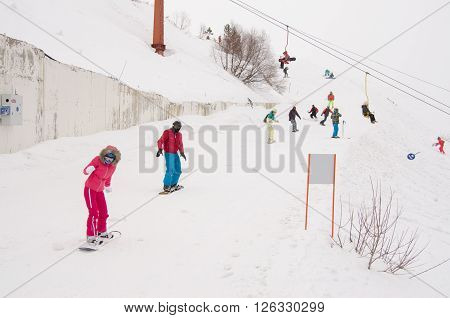 Dombay, Russia - February 7, 2015: People Ride On The Snow-covered Slopes Of The Ski Resort Dombai