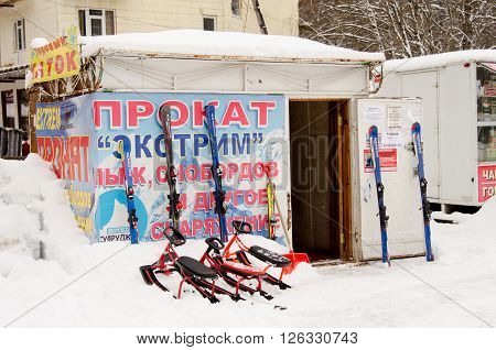 "Dombay, Russia - 7 February 2015: Rental Item ""extreme"" Skis, Snowboards And Other Equipme"