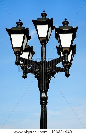 beautiful streetlight against the background of the spring blue sky