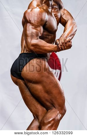 male professional athlete to compete in bodybuilding. tension biceps