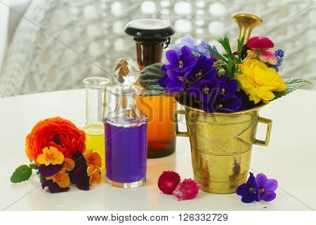 Flowers, mortar and bottles of potions, herbal medicine