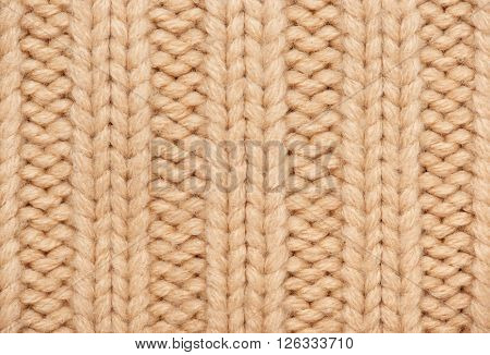 light brown and yellow knitted wool macro photo, texture background
