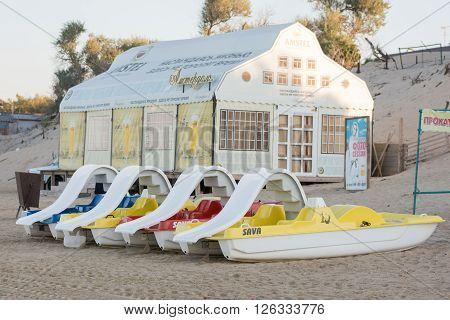 Anapa, Russia - September 21, 2015: Water Catamarans Are On The Sand In Front Of A Cafe On The Beach