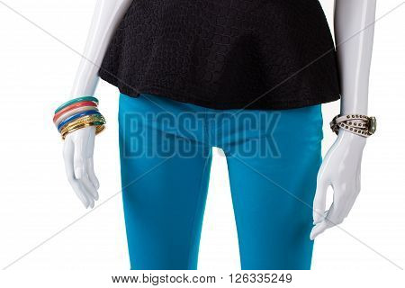 Black top and colorful bracelets. Female mannequin wearing bright bijouterie. Inexpensive accessories for young women. Merchandise that attracts customer's attention.