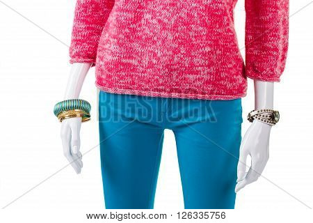 Turquoise trousers with pink pullover. Mannequin wearing sweater and pants. Lady's high-quality spring garment. Warm top with small accessories.