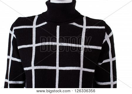 Black checkered high collar sweatshirt. Dark pattern sweater on mannequin. Woolen pullover of high quality. Lady's handmade autumn garment.