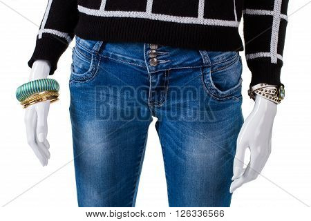 Sweater with low waist jeans. Mannequin wearing jeans and accessories. Lady's bracelet set with jeans. Simple pants on store showcase.