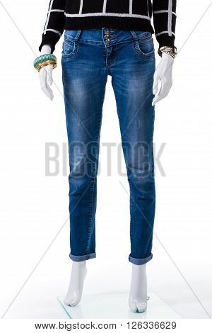 Blue jeans with dark pullover. Female mannequin in simple jeans. Combination of woman's autumn apparel. New denim pants on sale.