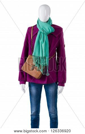 Turquoise scarf with purple coat. Female mannequin wearing birght scarf. Fashionable autumn clothing for girls. Warm outfit and brown purse.
