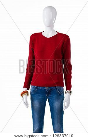 Simple red sweater with jeans. Red pullover on female mannequin. Lady's new high-quality clothes. Autumn outfit idea.