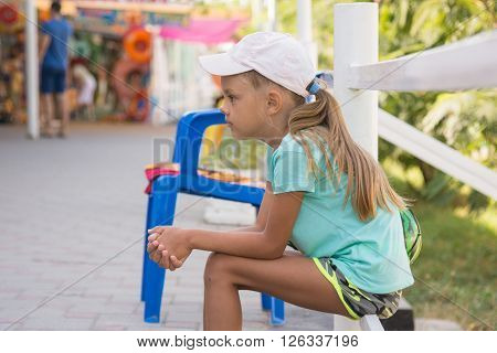 Girl Six Years Sitting In The Street And Waits