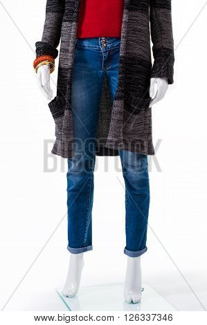 Striped sweater coat and jeans. Mannequin wearing long sweater coat. Girl's autumn outerwear on sale. Coat made of soft fabric.