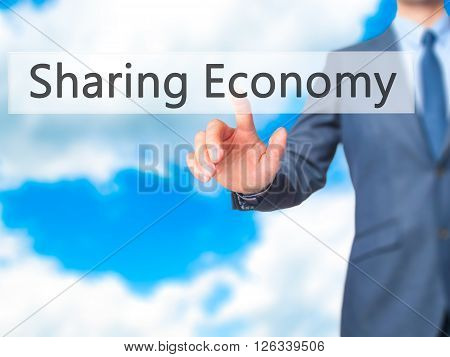 Sharing Economy - Businessman Hand Pressing Button On Touch Screen Interface.