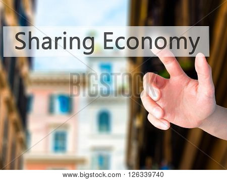 Sharing Economy - Hand Pressing A Button On Blurred Background Concept On Visual Screen.