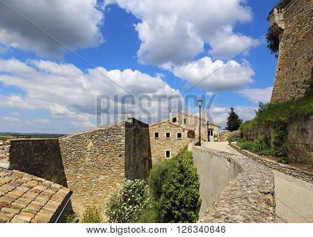 Landscape of southern France: old stone houses of the medieval village Grignan