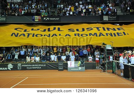 Beginning Of A Tennis Match. Crowd Singing National Anthem