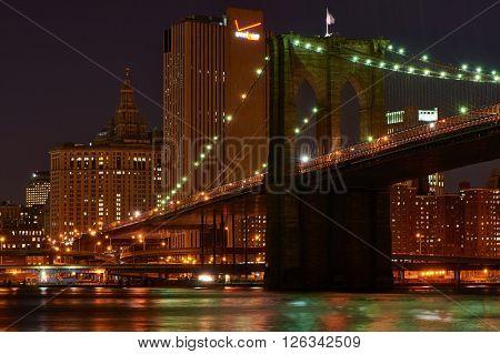 NEW YORK CITY - APRIL 2: Brooklyn Bridge with lower Manhattan skyline in New York City at night, USA,  April 2 2014 in New York, USA