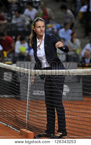 Tennis Referee Checking The Net