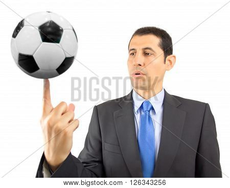 portrait of business man trainer playing with a soccer ball