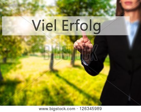 Viel Erfolg  (much Success In German) - Businesswoman Hand Pressing Button On Touch Screen Interface
