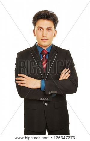 Business man with his arms crossed looking seriously into the camera